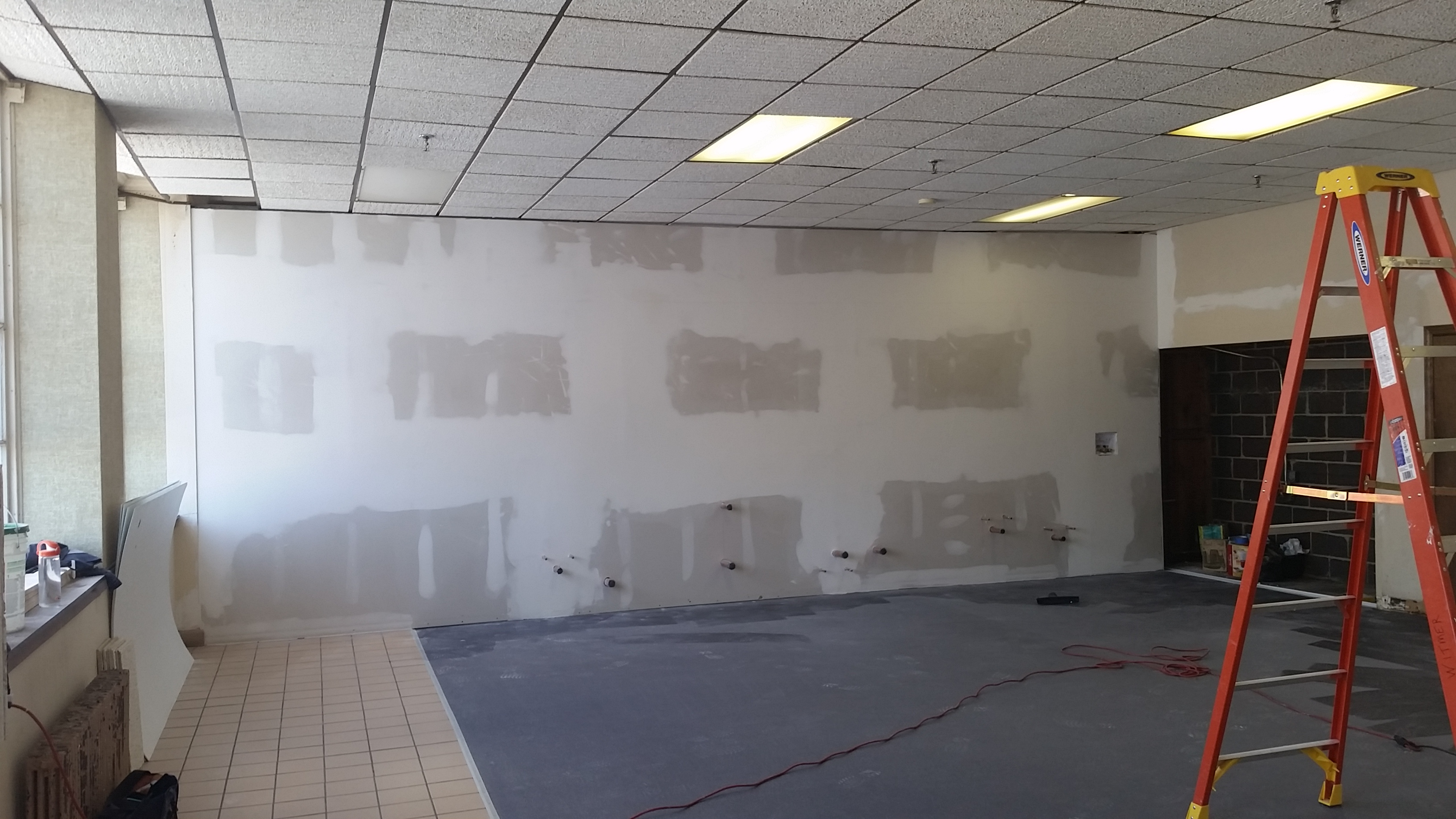 Dividing Wall Is In, Ceiling Tiles Are Up, And Initial Plumbing Is Almost Complete.